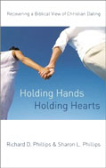 Image for Holding Hands, Holding Hearts: Recovering a Biblical View of Christian Dating.